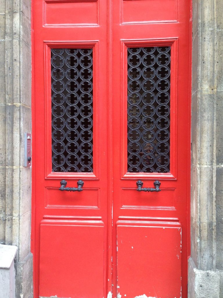 Just one of the many interesting doors in Paris....I loved this bright shade of coral-y red