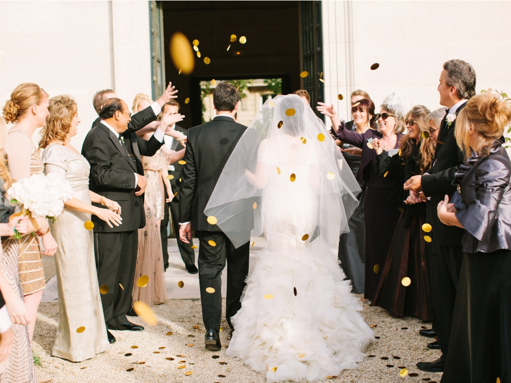 Guests tossed giant gold confetti as we exited the chapel into our